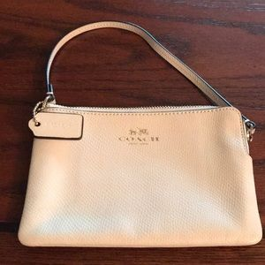 Coach ivory leather wristlet wallet
